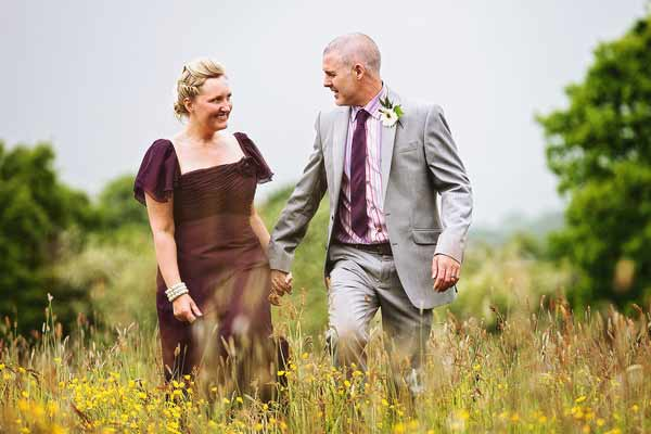 just-married-walking-fields